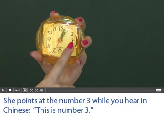 Screenshot of a video with professional Chinese actors on which one sees what he hears. She points at the number 3. She says in Chinese: This is number 3.